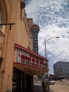 the Paramount Theatre opened May 19, 1930, as part of the Wooten Hotel development. The 3-story theatre features Spanish Colonial Revival architecture, Art Deco light fixtures and is best known for the stars and clouds that move across its ceiling. The theatre closed in 1979 and was saved from demolition by local preservation efforts. A complete restoration of the theatre was completed in 1987.
