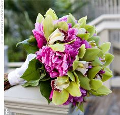 fuchsia peonies and green cymbidium orchids wrapped in white satin