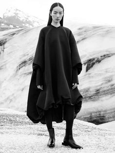 Minimal black dress with soft volume minimalist fashion editorial // COS