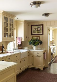 A Charming Connecticut Farmhouse by Gil Schafer - ***brackets below glass front cabs Kitchen Redo, Kitchen Styling, New Kitchen, Kitchen Ideas, Awesome Kitchen, Kitchen Cabinets With Feet, Yellow Kitchen Cabinets, Vintage Kitchen Cabinets, Country Kitchen Cabinets