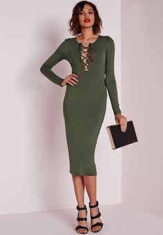 Raise some temps in this khaki bodycon dress. In a figure flattering jersey fabric this long sleeved number will give you that smokin' silhouette. With on point lace up front details this one has it all and we have major girl crush vibes ...