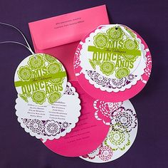 Circle Layers Quinceanera Invitations Floral designs are shown throughout this circle invitation. The layers are tied together at the top