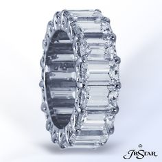 Emerald cut diamond eternity band with shared prongs.  By JB Star.  Available at Alson Jewelers.