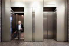 LEVELe Wall Cladding System with Blind panels in ViviChrome Chromis glass with custom color interlayer and Opalex finish, and LEVELe-105 Elevator Interiors at Mission City Corporate Center, San Diego, California
