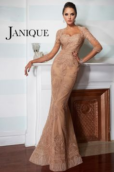 1e220719eb Janique celebrates femininity with this fabulous evening gown. This dress  has quarter length sleeves and a sculpted bodice.