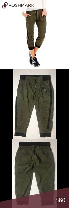 Lorna Jane Cargo Capri • Size M Great casual capris in and olive green with black stripe and cuffs • Size M • Elastic waistband with drawstring tie • Two zip up back pockets and one zip front and two side pockets • Like new Condition Lorna Jane Pants Capris