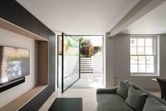 The #minimalwindowssystem is also available in a #pivotwindow design. These large format windows can be specified up to an impressive 3.7m high and 2.4m wide, and have a completely flush threshold for ease of access. The majority of the fixed frame can be hidden within the building finishes, creating an elegant, #minimallyframedglass door or window. Basement Flat, Living Room Decor, Living Spaces, Pivot Doors, Interior Design, Interior Modern, Modern Home Design, Interior Ideas, House Design