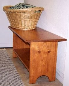 These Shaker bench plans are for the woodworking beginner. This bench could be used in the laundry room, as shown here, or as a coffee table, TV stand, or entry way bench.
