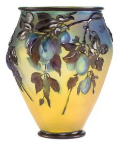 Sold For $24,000 in 2012   GALLE GLASS PRUNES BLOW-OUT VASE   Yellow glass overlaid with blue and mold-blown with plums amidst leafy branches, circa 1900  Marks: Galle (cameo)  12-5/8 inches high (32.1 cm)