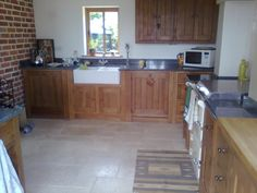 Nice oak kitchen with granite and wooden worktop, good idea!