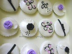 Formal cupcakes with roses, bows and blossoms. Wedding/Engagement cupcakes.