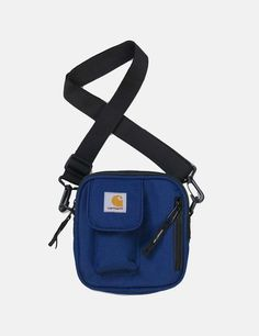 Polyester duck canvas from Carhartt. Water repellent fabric lined. Front flap pocket with velcro closure. Carhartt Bag, Essentials, Hip Bag, Black Backpack, Small Bags, Bag Accessories, Shoulder Strap, Usa, Blues