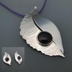 Zilveren hanger met amathyst. Hier zijn bijpassende oorbellen bij gemaakt.