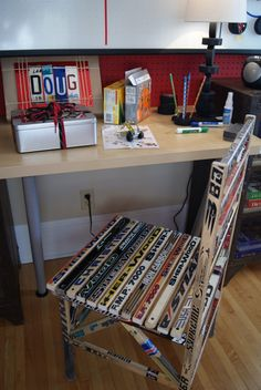 "I have seen hockey stick chair before. This actually looks pretty nice in this room.   Previous pinner:  ""hockey sticks turned into a chair, packages decorated w/shoelaces, license plate letters, & rubber bands"""