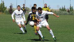 Our junior striker battling it out against Walla Walla University.
