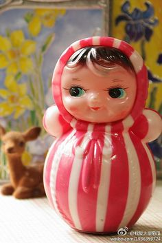 Vintage Roly Poly Doll - I just love these...this one particularly because of its peppermint-like stripes. ♡