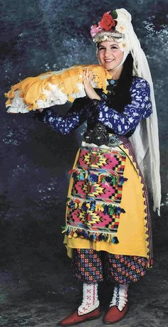 A traditional festive costume (a bridesmaid) of the district of Milâs (prov. Muğla). Clothing style: 2nd half of the 20th century. This is a recent workshop-made copy, as worn by folk dance groups.