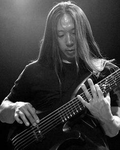 """John Myung (Dream Theater). When asked,""""Why pick up the bass guitar and not another instrument?"""" His response was: """"I think it's just in the way that you hear music. When I was growing up, and even now, the first thing that I hear is the bass. It doesn't matter who the artist is or what the song is – I hear that sound first.""""...Same as me, John. I agree with that statement."""