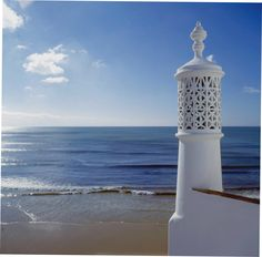 Walk around any town or village in the Algarve and you will see what appear to be minarets on the r. Algarve, House By The Sea, Azores, Portugal Travel, Moorish, Portuguese, Countryside, The Good Place, Scenery