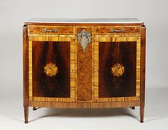 A petite Art Deco sideboard in the manner of Paul Follot Mahogany, zebrano and fruitwood inlays with engaged fluted legs and marble top. France, c.1925