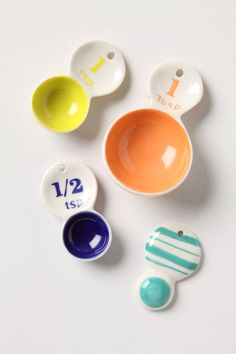 Color Tab Measuring Spoons - Anthropologie.com    Another splurge item, so lower on the list. They were just too darling not to pin though.