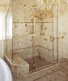Frameless shower door - I like the tile work in the shower stall, but not on the floor outside of it.