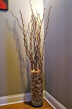 Vase, twigs & TONS of corks. Why haven't we thought of this before?