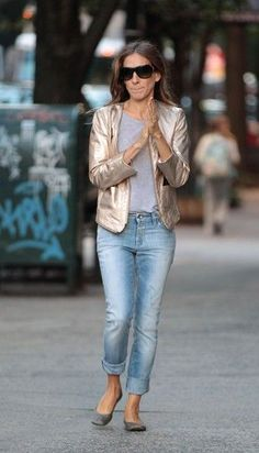 SJP in a gold blazer and faded jeans and flats. She could pop that metallic jacket over a black tie dress for cocktails, too. Metallics Are Neutrals, People. | Tina Adams Wardrobe Consulting