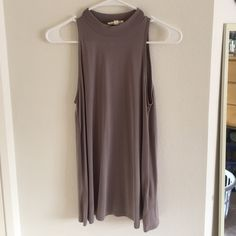 Urban Outfitters top Urban Outfitters top. Dark nude color. Super soft almost velvety to the touch. Urban Outfitters Tops