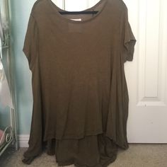 Free People SHIRT Longer in back and shorter in front. Loose. A little more green than it looks in this picture. Free People Tops