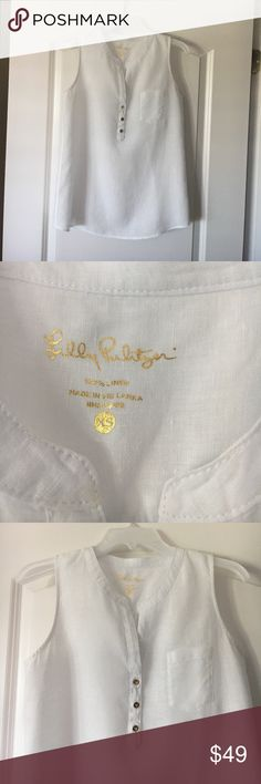 LILLY PULITZER KEY LARGO TUNIC XS In excellent used condition, only worn twice! White linen sleeveless Lilly tunic in extra small. Cool and lightweight, perfect for Summer, goes with everything! No stains or visible wear. Comes from an immaculate smoke-free, pet-free home. Lilly Pulitzer Tops Tank Tops