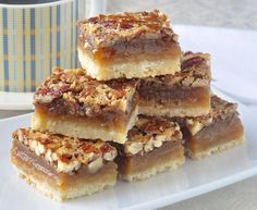 The Best Pecan Pie Bars - this easy recipe includes a simple shortbread bottom and a one bowl mix & pour topping. Tips for baking and cutting them are included. # Easy Recipes baking The Best Pecan Pie Bars - so quick & easy to make! Pecan Desserts, Pecan Recipes, No Bake Desserts, Just Desserts, Sweet Recipes, Cookie Recipes, Delicious Desserts, Rock Recipes, Recipe For Pecan Pie Bars