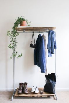 love this simple + rustic clothing rack for an entryway idea. Vintage charm meets minimalistic beauty.  A Tiny Home for Two Designers in Wales | Design*Sponge