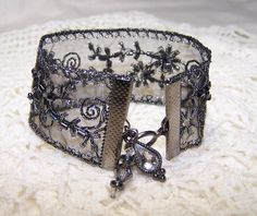 Gunmetal Beaded Ribbon Bracelet with Charms Formal Goth Steampunk Cuff Sparkle Black and Silver Victorian Vintage Look Boho Bohemian. $14.00, via Etsy.