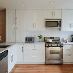 Philadelphia KitchenLocation: Philadelphia, Pennsylvania  A basic Ikea kicthen with simple appliances, is made special with overscale  hardware, caesarstone counters and elongated subway tile.