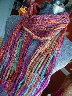 crochet scarf -- the pattern is in Finnish --it appears to be crocheted lengthwise with long chains between single crochet sections