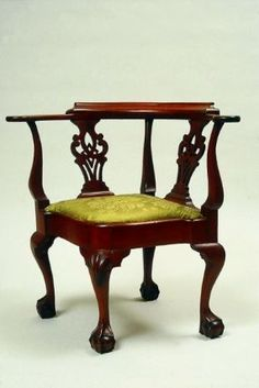 """1760-1775 American (New York) Roundabout chair at the Museum of Fine Arts, Boston - From the curators' comments: """"Chairs with round backs were made throughout the colonies and used in several different rooms, often paired with a desk or writing table. The low arms fit under a writing surface, while still providing elbow support for the user. Although variously called corner chairs, round chairs, three-cornered chairs, or triangular chairs, the most common name is roundabout chair."""""""
