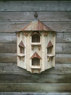 Dovecote. Purchased by patron to hang on bedroom wall, putting candles in archway.