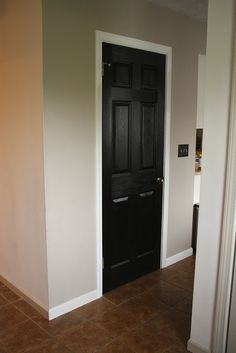 Greige walls, white trim, black internal doors