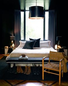 Moody Cool: A Gallery of Dark Bedrooms  Black and gold is always a good idea. And bonus points for painting the ceiling, too. From Jeremiah Brent.