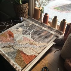 Weaving on the loom by Maryanne moodie