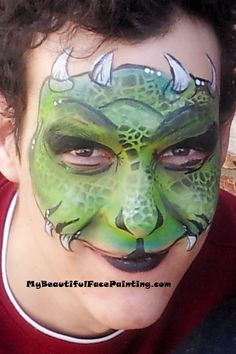 Green monster face paint mask. Green, yellow Tag split. Scales applied with a Bam stencil and Mehron black pressed powder. DFX white and black for line work.
