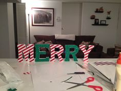 DYI Christmas decor...Wood letters and scrapbook paper from Michael's