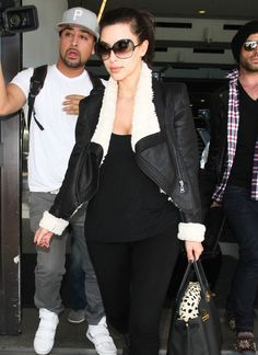 Kim Kardashian Bomber Jacket - Kim Kardashian looked ready to take flight in a black bomber jacket and Jackie O shades.