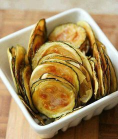 Zucchini Chips :  Dip 2 1/2 cups sliced zucchini in low fat milk and dredge in a mixture of 1/4 cup ground almonds,1/4 cup parmesan cheese,and 1/4 tsp seasoned salt. Bake on sprayed baking pan at 450 degrees for 30 minutes.  Serve immediately