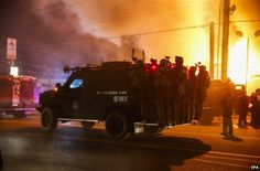 BRITAIN - BBC - Ferguson riots: Ruling sparks night of violence. The US town of Ferguson has seen rioting and looting after a jury decided not to bring charges over the killing of a black teenager.