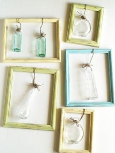vases tied to picture frames for single flowers
