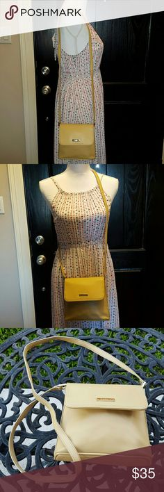 Liz Claiborne cross over bag Beige cross over purse. Used. Has one scuff on front of purse as pictured and a small lipstick mark on flap. Good condition. $35 OBO Liz Claiborne Bags Crossbody Bags