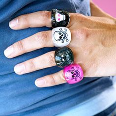 Take a clear acrylic dome ring and paint a design or decoupage your favorite paper to the inside.