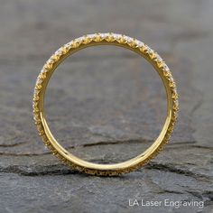 EternityYellow Gold Diamond Wedding Band ,with Diamonds all around the ring  18k Yellow Gold 1.80mm wire width  Diamonds 0.51 ct.  Micro Pave setting ( French Pave)  Hand Made  Ring not Resizeable  Free Personal Laser Engraving Return within 10 business days after receive the package Charge $50 restocking fee
